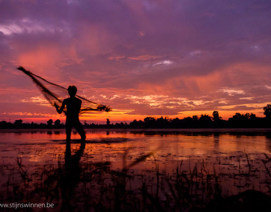 Fisherman in siem reap at sunrise