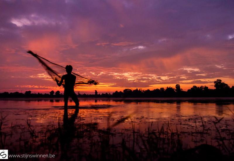 Fisherman in siem reap at sunrise