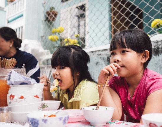 Kids having street food breakfast in Nha Trang